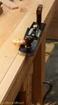 Used my jack plane to create a bevel that angles down toward the picture.  I set the angle of the bevel by penciling in the depth and the width and planed to both.