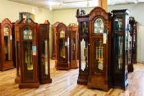 The army of grandfather clocks in the Amana Furniture store.