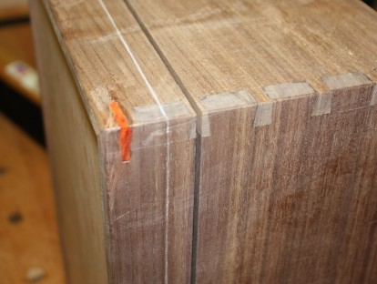 A close up of kerf with paduk miter spline.