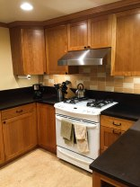 Stove and Cherry Cabinets